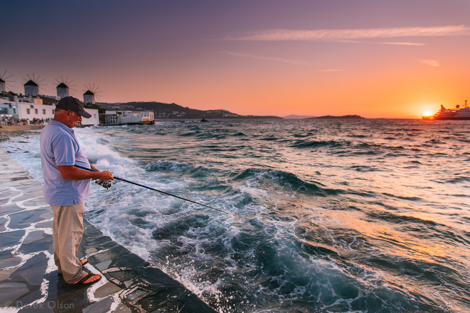 The fisherman does not look too distorted that close to the edge -- impressive! / Sunset in Mykonos