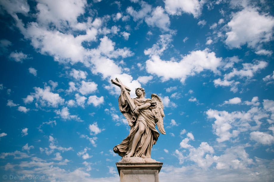 Statue holding cross